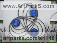 Forged Steel and Blown Glass Celtic Knot Work and Traditional sculpture by Jenny Pickford titled: 'Celtic Screen (Glass Floral Suspended sculptures)'