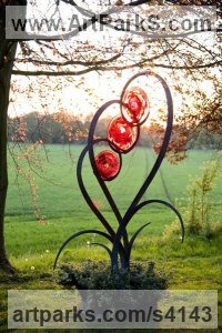 Forged steel and blown glass Glass or Acrylic Transparant sculpture by Jenny Pickford titled: 'Unfurl (Large Glass Flower Plant garden/yard statue)'
