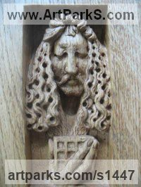 Wood - oak Wall Mounted or Wall Hanging sculpture by Jiř� Net�k titled: 'Selfportrait of A.D. (Small Carved Face Commission Plaques panel)'