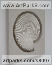 Stucco & wood mount Shells Sculptures including Land and Sea and Freshwater Shells Fossil Shells sculpture by John Douglas Joyce titled: 'Ammonite sculpture (Wall Mounted in titanium white stucco)'