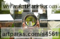 Stainless Steel Religious sculpture by Jon Barlow Hudson titled: 'CUNIUNCTIO OPPORITORUM (Contemporary stainless Steel Cross)'