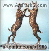 Bronze Hares and Rabbits sculpture by Jon Bickley titled: 'Boxing Hares (bronze Metal Mad March Pair sculptures)'