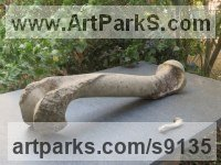 Granito, talla directa Dogs sculpture by Juan Cabeza Quiles titled: 'F�mur de Perro (Carved Outsize Thigh Bone statue)'