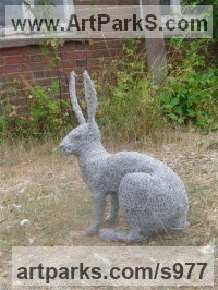 Hares and Rabbits Sculpture by sculptor artist Lucia Corrigan titled: 'Sitting Hare (Metal Wire Mesh Outside garden/Yard life size sculpture)' in Metal wire