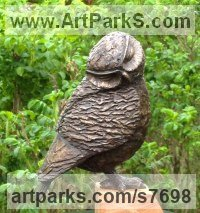 Bronze resin (cold cast bronze) and oak base Small bird sculpture by Marie Shepherd titled: 'Little Owl III (Drowsing Resting statuette statue)'