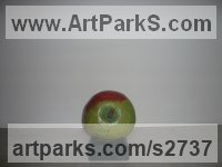 Terracotta Fruit sculpture by sculptor Marta Leiva Gibbs titled: 'Apple (Outsize Coloured Terracotta Inside sculptures)'