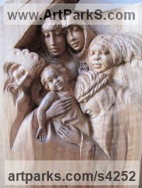 Walnut Mother and Child, the Madonna, mother and children sculpture by Martina Net�kov� titled: 'King of Kings (Wood Holy Family Wall statues/carving)'