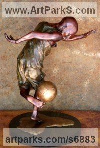 Bronze Footballers Football Players Soccer Players sculpture statue statuettes sculpture by Michael J Mawdsley titled: 'Aspirations (bronze African Boy Playing Football statue sculpture)'