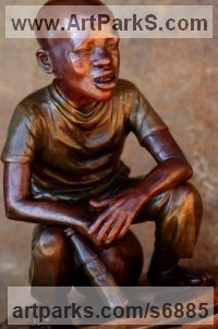 Bronze Sculpture of Children by Michael J Mawdsley titled: 'The Wannabe (bronze African Boy Football Supporter statue sculpture)'