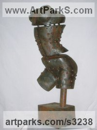 Surrealist Sculpture by sculptor artist Mitchell House titled: 'Woman Under Construction (Iron Maiden Torso statue)' in Cold cast iron