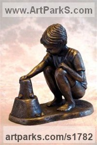 Bronze Resin Sculpture of Children by Moira Purver titled: 'Building Sandcastles (Small Boy Playing Beach Sitting sculpture statue)'