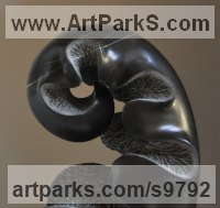 Black stone Small / Little Abstract Contemporary Sculptures / Statues sculpture by Nando Alvarez titled: 'Black Sprout (Black Carved Young Fern Frond statues)'
