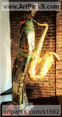 Musician and Musical Sculpture by sculptor artist Nicholas B. Daddazio titled: 'G.W., Jr' in Papi�r mach