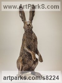 Bronze resin Hares and Rabbits sculpture by sculptor Nick Mackman titled: 'Hare on Haunches (Mad March on haunches statuettes)'