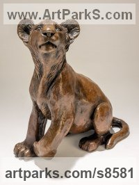 Bronze African Animal and Wildlife sculpture by sculptor Nick Mackman titled: 'Lion Cub (Little Bronze lion cub statuette figurine)'