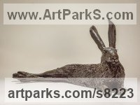 Bronze resin Hares and Rabbits sculpture by Nick Mackman titled: 'Lying Hare (Sitting Lying Resting Hare figurines)'