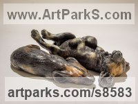 Bronze African Animal and Wildlife sculpture by Nick Mackman titled: 'Wild Dog Pup (one bronze wild dog pup statuette/figurine)'