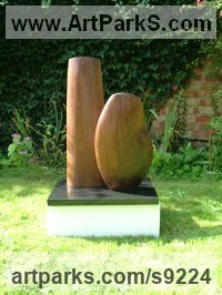 Black Walnut Carved Wood sculpture by Nicola Beattie titled: 'Harmony (Minimalist carved Man and Woman statue)'