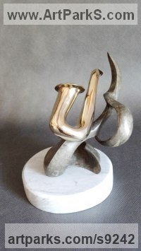 Bronze on stone Musician and Musical sculpture by Biela Panufnik titled: 'Little Saxophone (abstract Wind Instrument statues)'