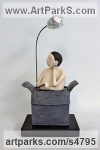 Ceramic mounted on ebonised wood Human Figurative sculpture by sculptor Paul Cox titled: 'Outside the Box (Naive Boy Box and Balloon statues Ornament Figurine)'