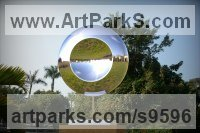 Stainless Steel Round Disk, Dish, Flat Circular Ring Shaped Sculptures / Statues statuette statuary sculpture by Paul Wesson titled: 'Another Space No.4 (stainless Steel garden Disc statue)'