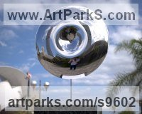 Stainless Steel Round Disk, Dish, Flat Circular Ring Shaped Sculptures / Statues statuette statuary sculpture by Paul Wesson titled: 'Black Hole No.2 (stainless Steel Yard Round statues)'