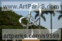 Stainless Steel Stainless Steel Abstract Contemporary Modern sculpture by Paul Wesson titled: 'Swing Space 5 (stainless Steel Circular Yard statues)'
