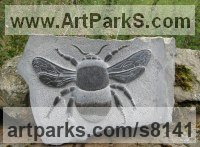 Black weardale marble Garden Bird and Animal sculpture by Peter Graham titled: '`Bumble Bee` (Carved stone Big Low Relief statuette)'