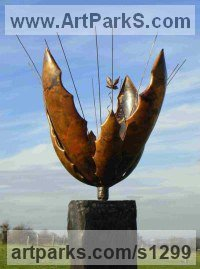Copper/Wooden Plinth Fruit sculpture by Peter M Clarke titled: 'Seed Pod Vl (Large Plant Seed Pod garden sculpture)'
