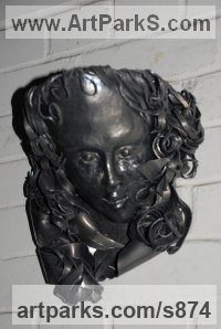 Lead Sculptures of females by Peter Newsome titled: 'Thoughtfulness (Beaten Lead Face sculpture)'