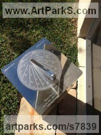 Stainless Steel Sundials sculpture by Piers Nicholson titled: 'Memorial Sundial in a garden in Florida'