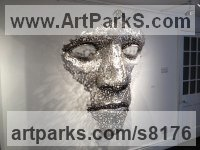 Stainless Steel or mild Steel coins Wall Mounted or Wall Hanging sculpture by Rick Kirby titled: 'Cloud Formation (abstract Outsize Mans Face sxculpture)'