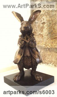 Hares and Rabbits sculpture by Sara Ross titled: 'Storytime (Rabbit Clothed and Reading a Book sculptures)'
