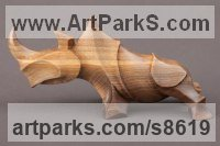 Wood: walnut Carved Wood sculpture by Sergey Chechenov titled: 'Rhino (Stylised Contemporary Carved Wood sculpture)'