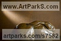 Bronze Animal Abstract Contemporary Modern Stylised Minimalist sculpture by Simon Gudgeon titled: 'Buddha Hare (Bronze Sleeping Resting outdoor statue)'