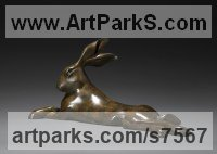 Bronze Hares and Rabbits sculpture by Simon Gudgeon titled: 'Reclining Hare (Resting Mad March Hare garden statue)'