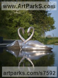 Bronze Wild Bird sculpture by Simon Gudgeon titled: 'Swans (White life size Swans Swimming statue)'