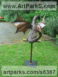 Copper Balancing sculpture by Stanley Jankowski titled: 'Copper Dragon (life size Baby Dragon sculpture for Yard or garden)'