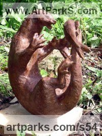 Bronze Badger, Otter, Beaver, Weasel, Stoat, Pine Martin, Wombat sculpture by Sukey Erland titled: 'Otter playing with Fish (Nearly life size Yard statue)'