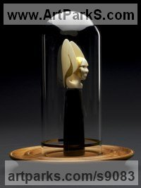 Orca Tooth, Gold leaf, hand blown glass, ebony wood, walnut Gods or Goddess, or Deity sculpture by sculptor Tony Mayo titled: 'Angel of The Lord (Little Winged Head Carved statuette)'