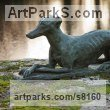 Bronze or Resin Dogs sculpture by sculptor Alison Murray Wells titled: 'Lurcher (life size Resting Poised garden Outdoor sculpture)'