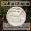 Sandstone Small bird sculpture by Anthony Bartyla titled: 'Jenny Wren on a Fence (Carved Circular Plaque statue)'