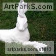 Cast marble resin Hares and Rabbits sculpture by sculptor Christine Close titled: 'Hare Line (marble resin Big Fun Hare Lying Alert sculpture)'
