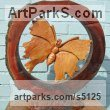 Cedar,elm,and oak Round Disk, Dish, Flat Circular Ring Shaped Sculptures / Statues statuette statuary sculpture by David Gross titled: 'Ring fenced 2 (Big Butterfly Carved Wood garden or Yard statues)'