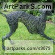 Painted galvinised steel wire Dogs sculpture by sculptor Emma Walker titled: '`Young Whippet Playing` 1 (Wire garden abstract statue)'