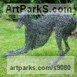Painted galvinised steel wire Dogs sculpture by sculptor Emma Walker titled: '`young whippet playing` 2 study wire'