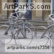 Steel Stylized People sculpture by sculptor Graham Anderton titled: 'Cyclist (life size Yorkshire Tour de France Bicycle sculpture)'