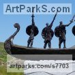 Foundry cast bronze / carved stone Male Men Youths Masculine Statues Sculptures statuettes figurines sculpture by Hans Blank titled: 'Viking Warriors (abstract Norsemen statuettes statue)'