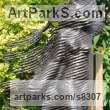 Bronze on wood Clothes Dresses Gowns Shirts etc sculpture sculpture by sculptor Hans Koenen titled: 'The Phantom (bronze female in WornRagged clothing garden statue)' - Artwork View 1