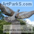 Bronze on Riven slate Obelisc Wild Bird sculpture by sculptor JOEL Walker titled: 'Turtle Dove (Bronze life size Coloured Flying statues)'